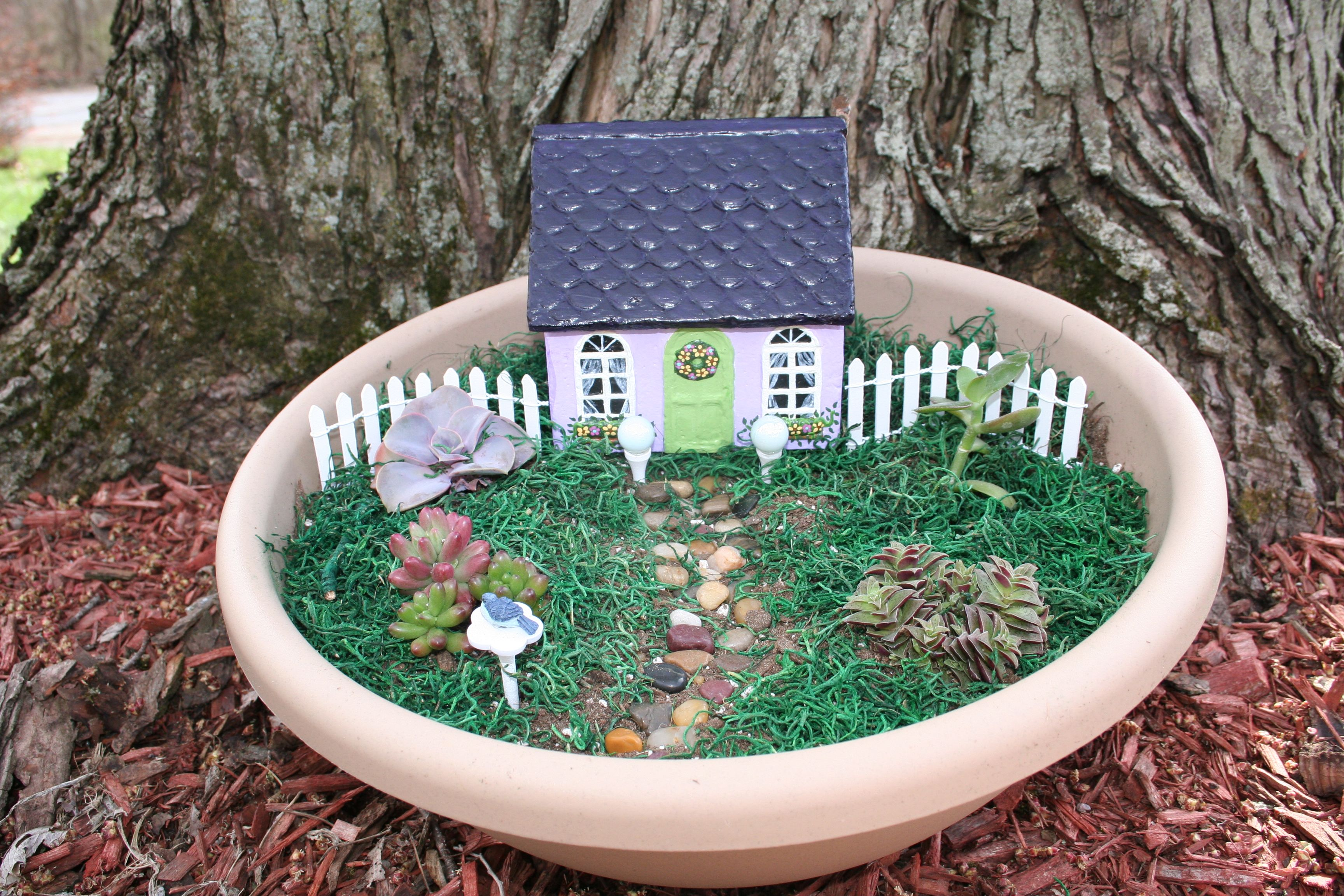 Purple fairy house in kit. Contains everything you see, just add dirt!