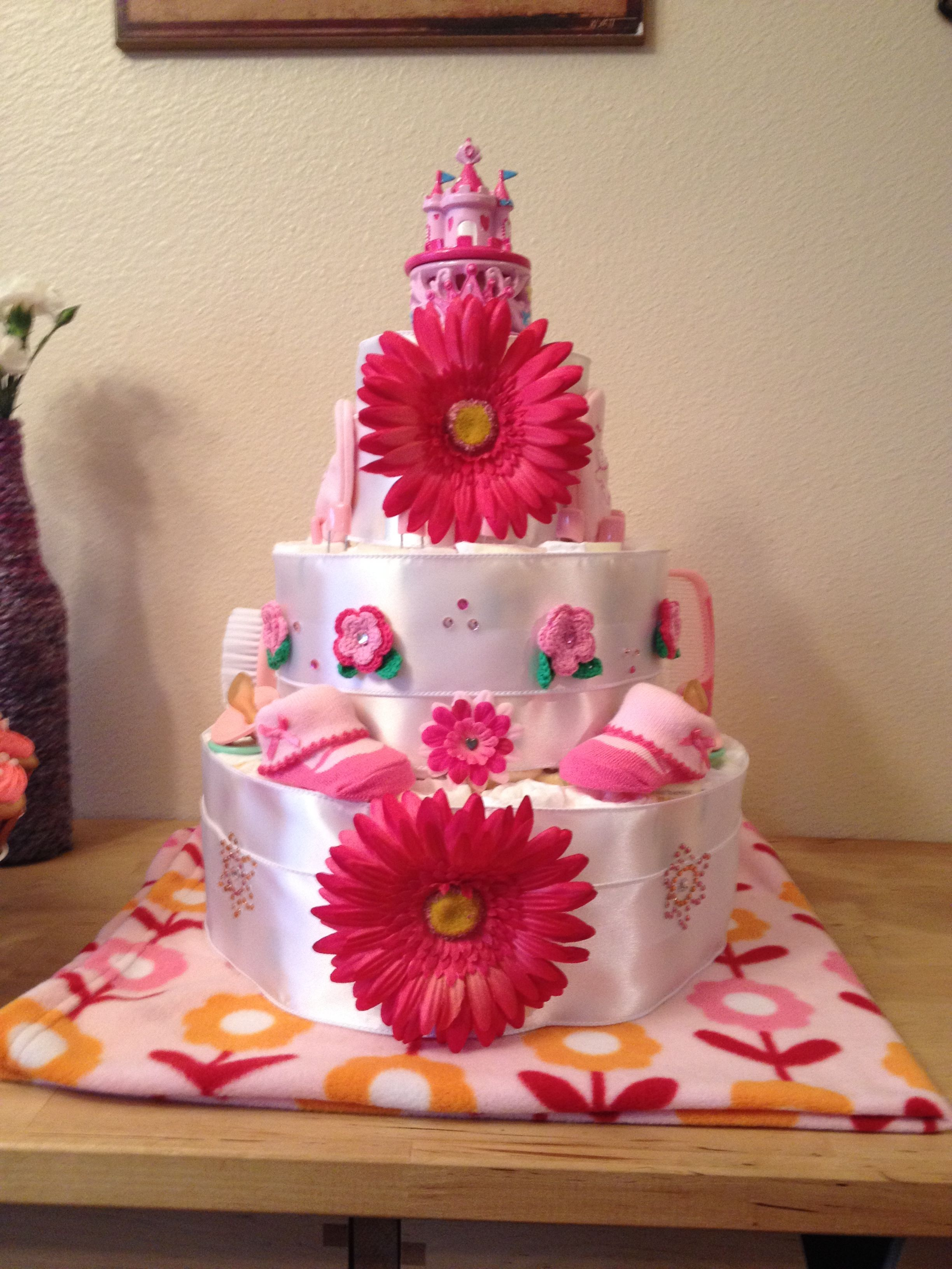 My signature baby shower gift is a personalized diaper cake.