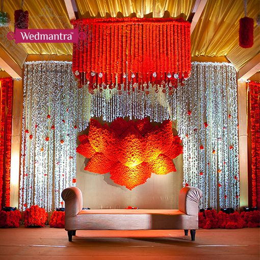 Wedding Stage Flower Decoration: Auspicious Lotus Motif Backdrop For The Stage. #wedmantra