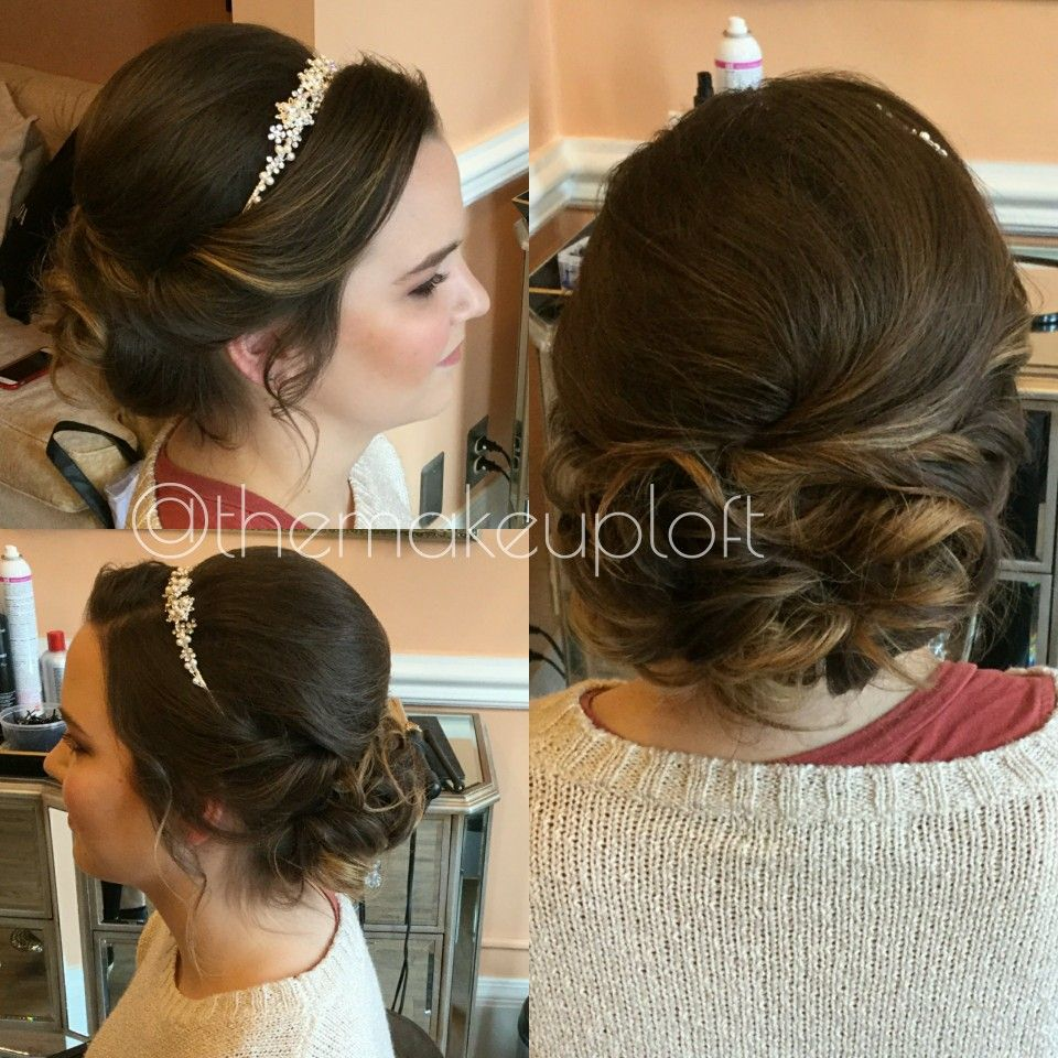 formal brunette updo teased low bun with headband | brunette