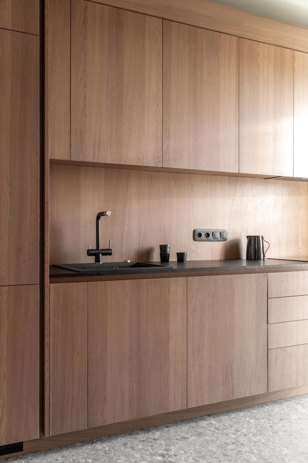 Wood Cabinets Without Hardware Are A Consistent Feature Throughout This Apartment In 2020 Wood Cabinets Modern Wood Kitchen Built In Furniture
