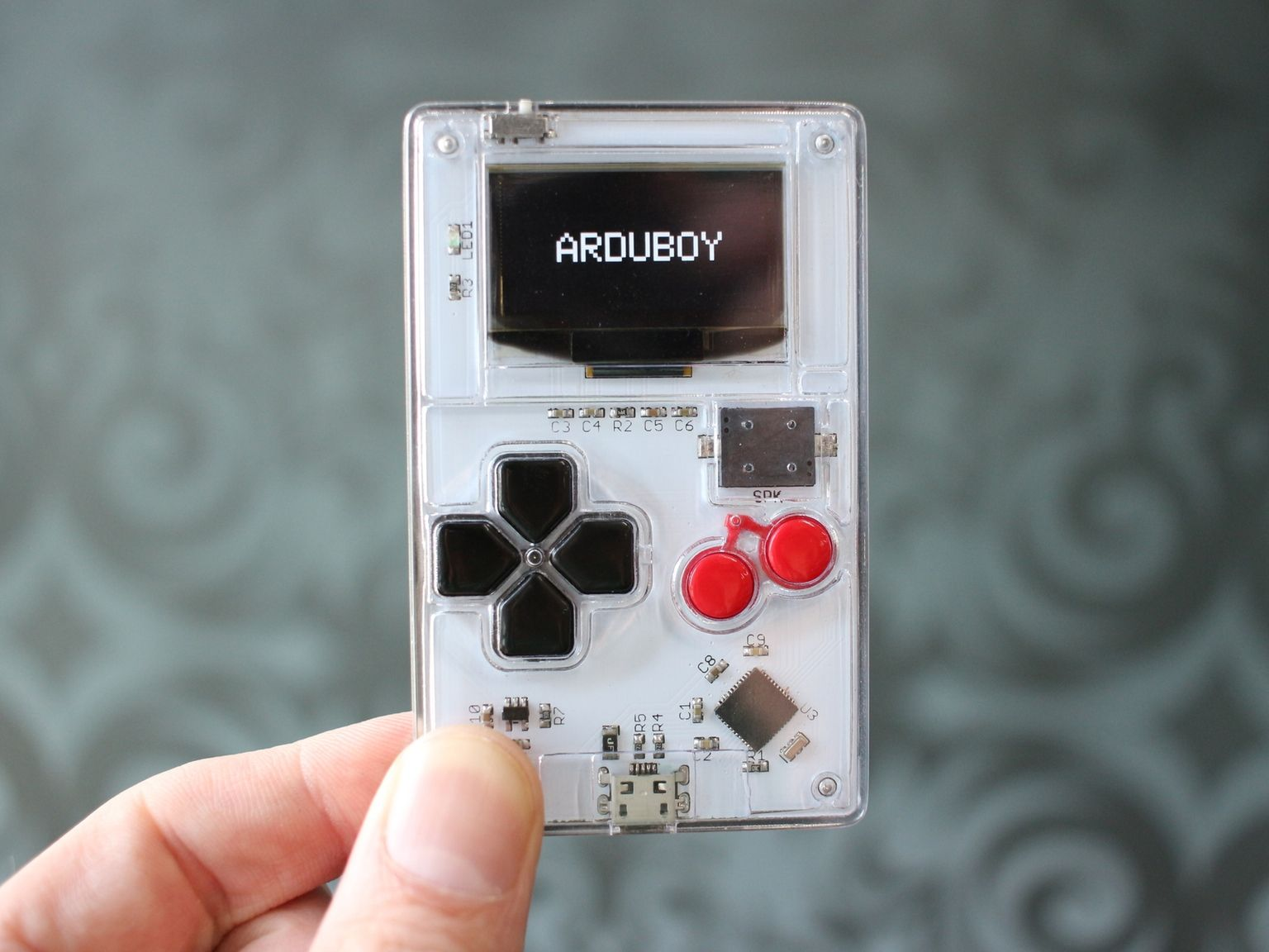 Arduboy The Game System The Size Of A Credit Card The Easiest Way To Play Make And Share 8 Bit Games Powered By Arduino Gameboy Make Your Own Game Arduino