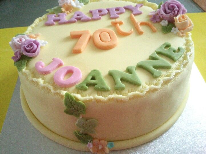 70th Lemon fondant birthday cake with mini roses ivy leaves and
