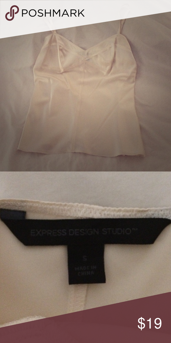 Express camisole top Beautiful cream colored camisole blouse. Great for night out or under jacket for work!!Worn just a few times- like new! 92% silk, 8% spandex. Express Tops Camisoles