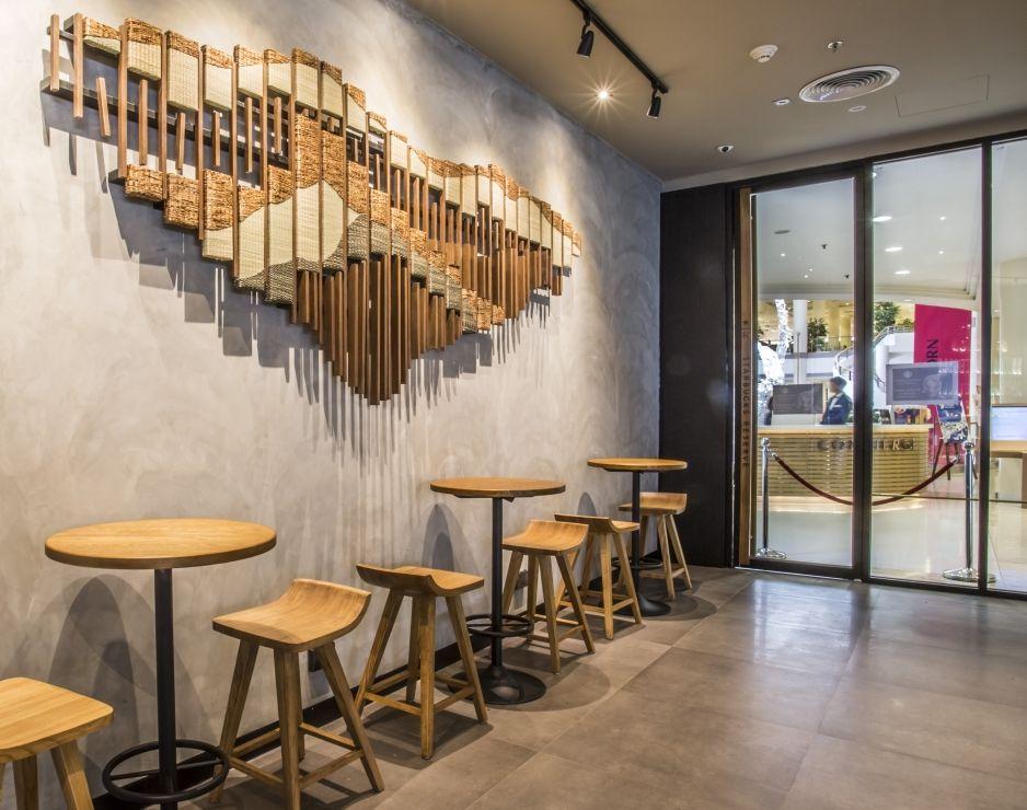 Local art enhances the starbucks customer experience in