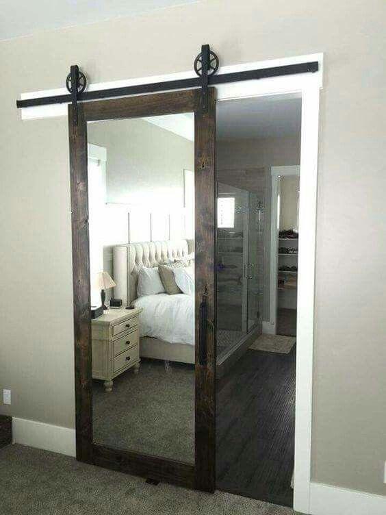 A barn door sliding mirror    such a great idea! Walkin