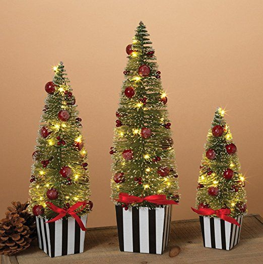 set of 3 pre lit battery operated tabletop christmas trees with berries and light snow 12 10 and 75 inches high artificial bottle brush tree