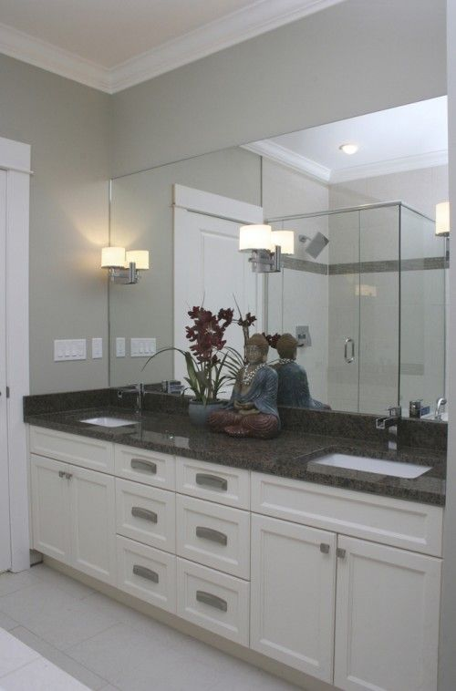 Wall sconces attached to the mirror with Kenzo bathroom ...
