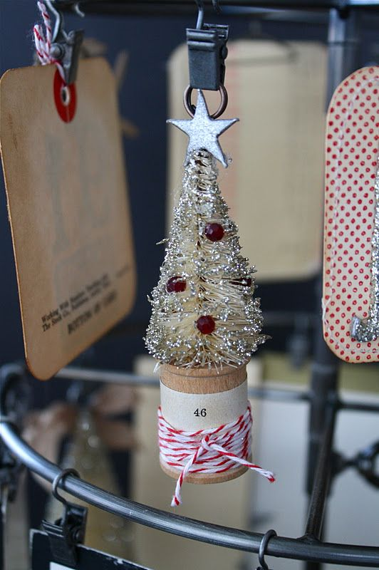 This little tree in the wooden spool has red beads from an old necklace.