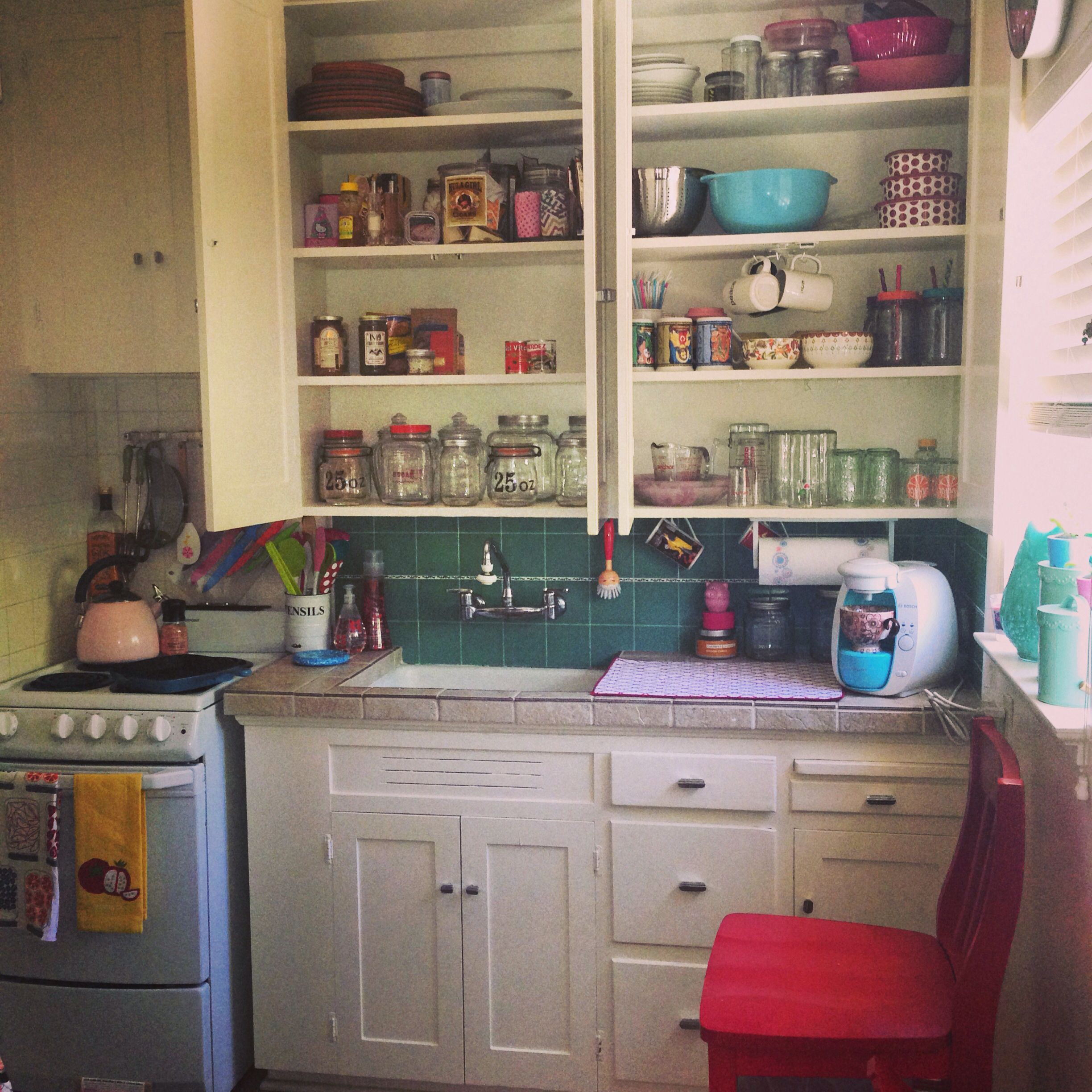Glass Canisters To Store Food In My Deep 1940s Kitchen Cabinets 1940s Kitchen Kitchen Cabinets Kitchen