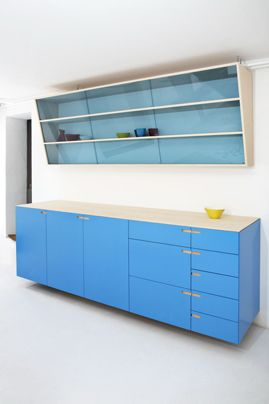 modernist kitchen | Nicolaj Bo  not afraid to use colour on cabinet fronts if it easily poss. not keen on top angular cupboards tho