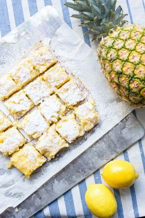 Classic lemon bars with a modern tropical twist. These Pineapple Lemon bars will bring back nostalgic memories of favorite childhood desserts. Creamy lemon curd over a dense cookie crust - www.platingpixels.com