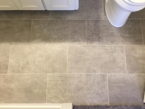 this 12x24 porcelain floor tile was installed in a running bond