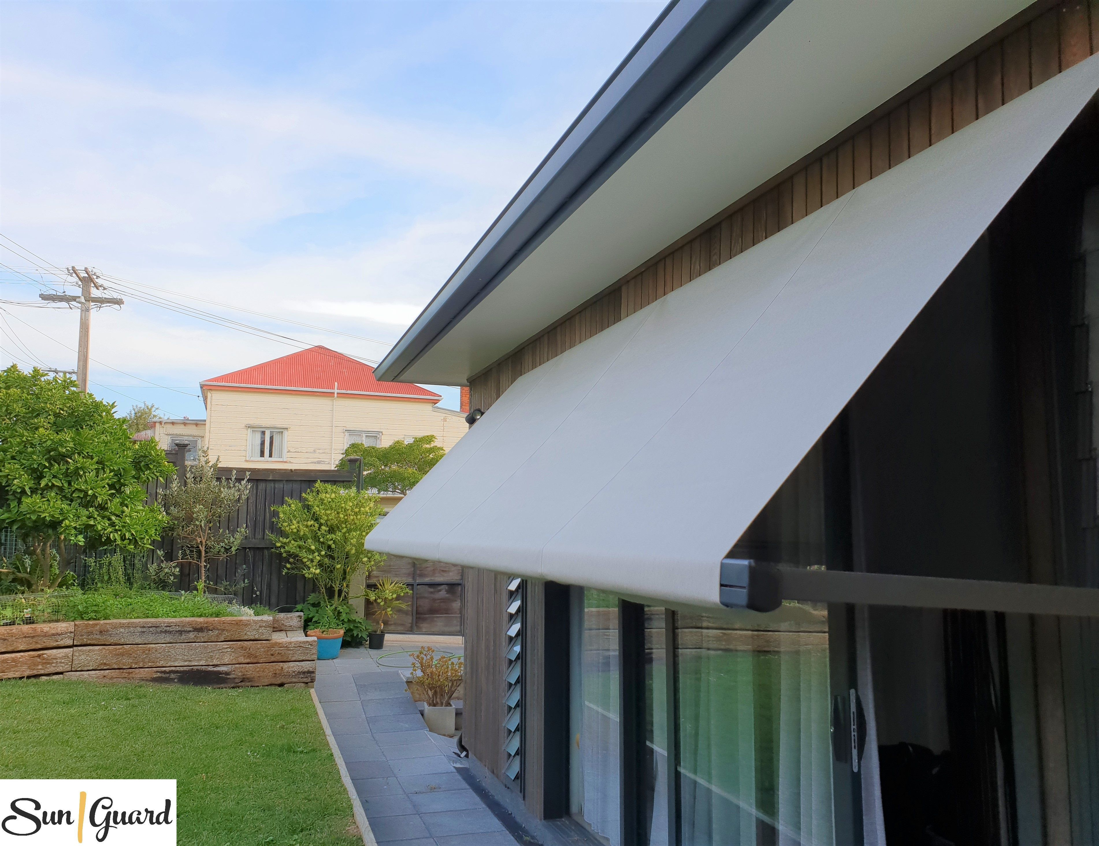 This Stylish Drop Arm Awning Has Been Recently Installed In Grey Lynn Auckland Drop Arm Awnings Are Great For Windy Areas Outdoor Decor Awning Installation