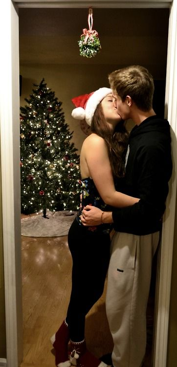Christmas Kiss.I Pinned This Because Her Socks Are Cute
