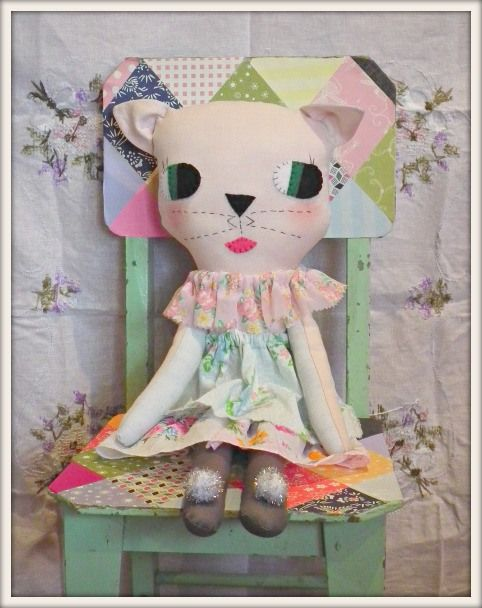 Love the kitty and her pretty spring coloured dress.