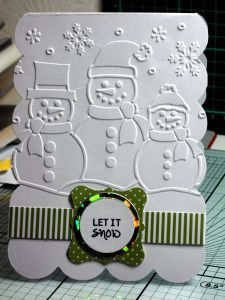 Christmas card, white embossed snowmen with 'Let it Snow' sentiment band.