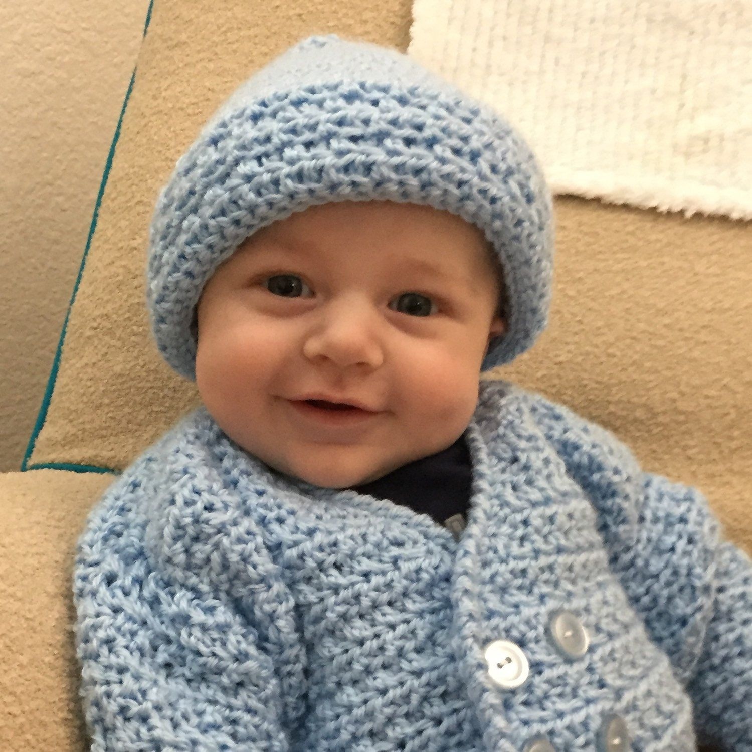 My bosses' grandson is so cute in this picture wearing one of my crocheted sweaters. Perfect for any little man. Look at that smile!