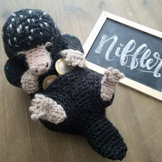 Newts Niffler Amigurumi pattern by Inky Fox the Yarn Bandit #amigurumimodelleri Where'd that necklace go? I thought I had some rare gold coins lying around… Anyone seen my wallet anywhere? #babyyarn