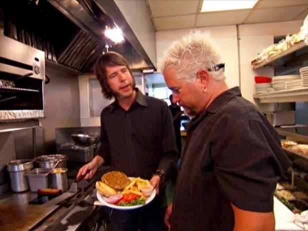 At Salt Lake City's Blue Plate Diner, Guy samples a juicy vegan burger.