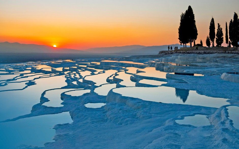 Pamukkale springs, Turkey: This mineral-bath spa draws in visitors because of its natural beauty. Here, hot calcium-laden waters spring from the earth and cascade over a cliff, and as they cool they form hard, brilliantly white calcium that form pools.