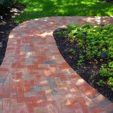 Decorative Brick Pavers lay decorative pavers in an attractive pattern to draw the eye to