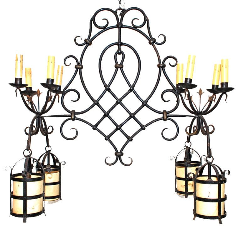 A Large antique  French 1940  Wrought Iron Chandelier   From a unique collection of antique and modern chandeliers and pendants  at https://www.1stdibs.com/furniture/lighting/chandeliers-pendant-lights/