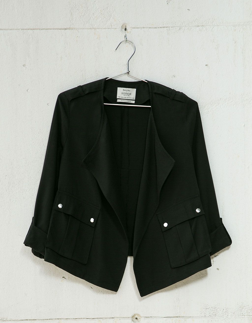 Draped jacket with utility pocket. Discover this and many