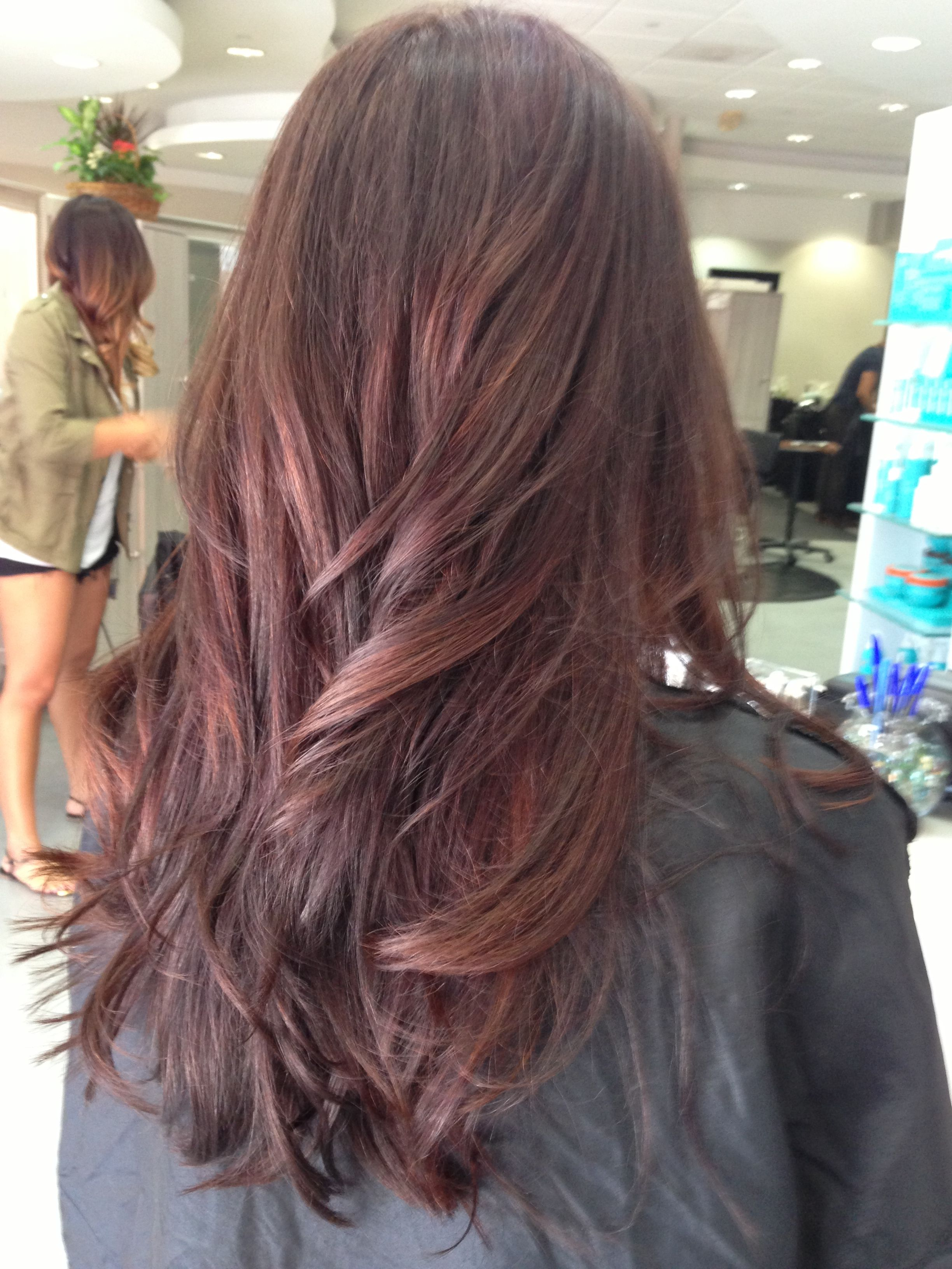 Subtle dark auburn balayage for a demensional in your solid hair