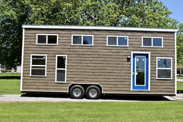This is a 3 bedroom tiny house on wheels called the Chalet Shack