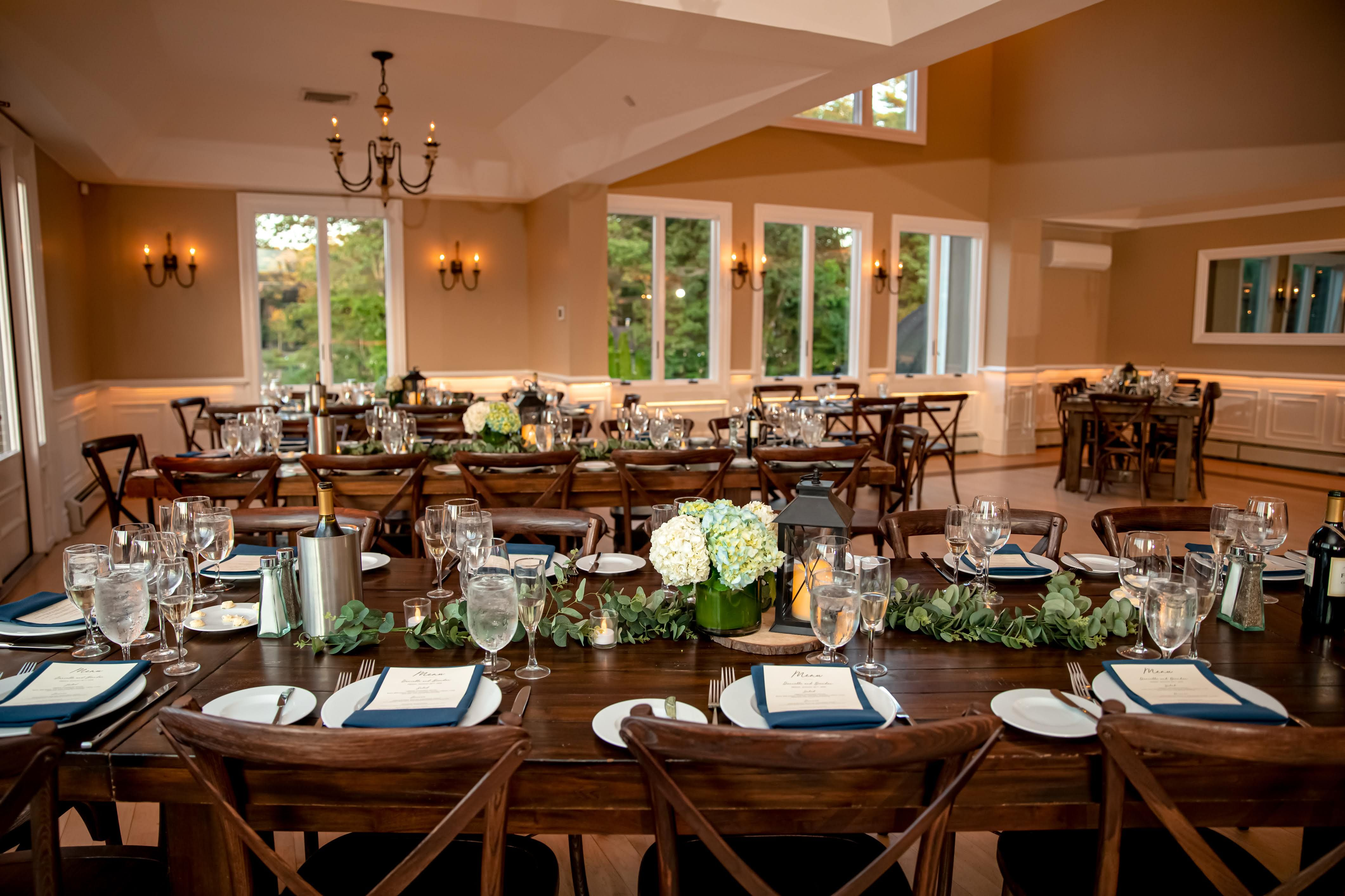 Rustic farmhouse tables in the ballroom of this nature ...