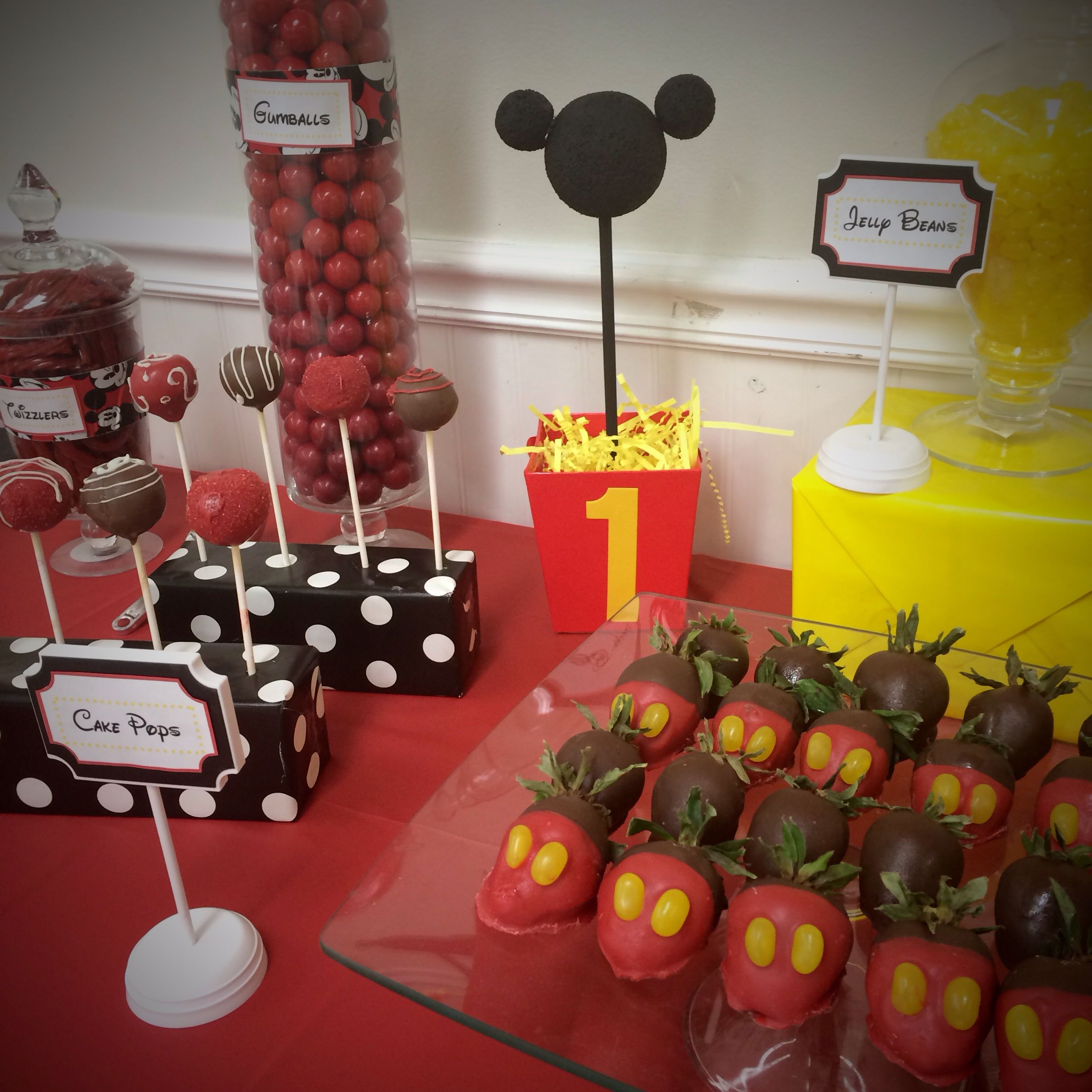 mickey mouse first birthday party dessert table candy bar buffet red yellow brown black chocolate covered