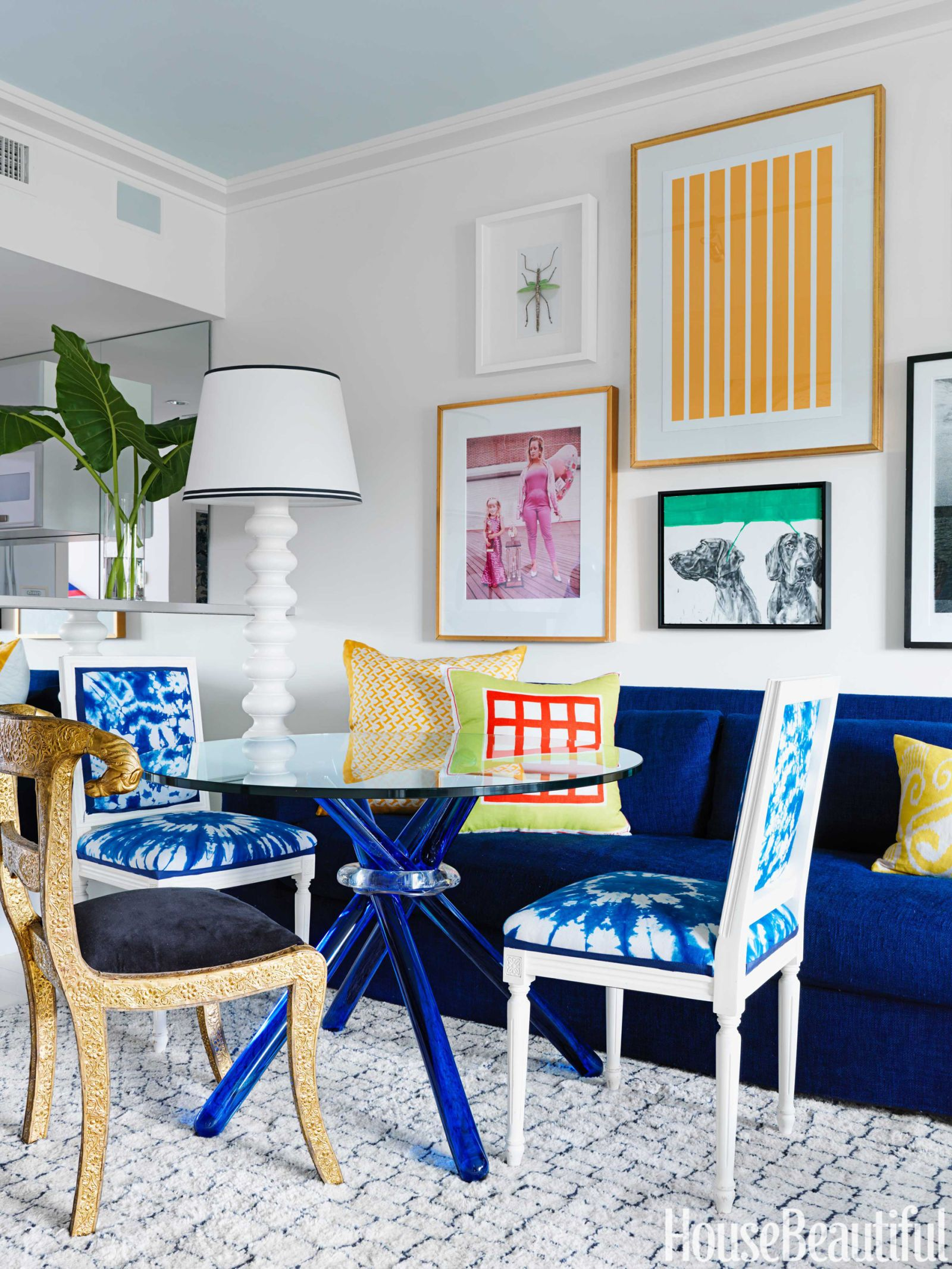 a colorful and modern miami apartment louis xvi glass table and