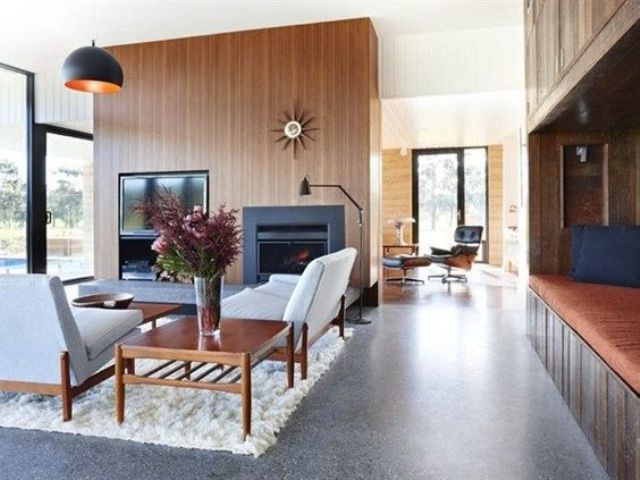 Polished Concrete Floors Are Rather Cold So You Can Add Comfy Rugs Concrete Floors Living Room Polished Concrete Rammed Earth Homes