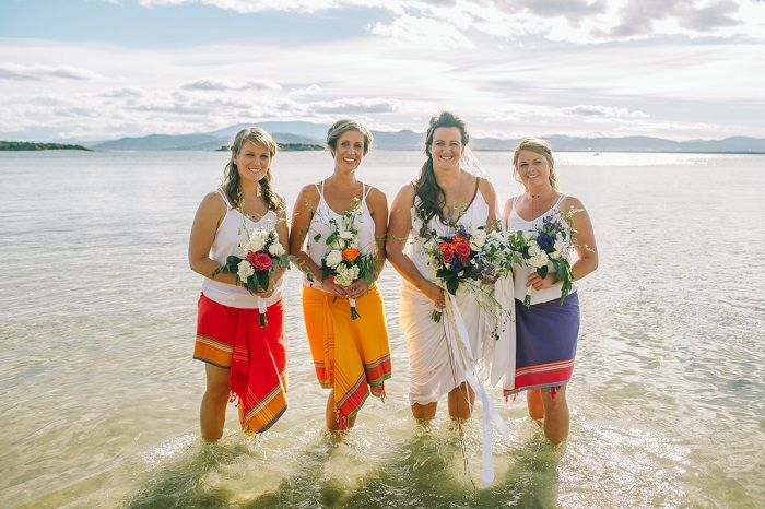 Colourful bridesmaids wear salongs - beach wedding #beachwedding