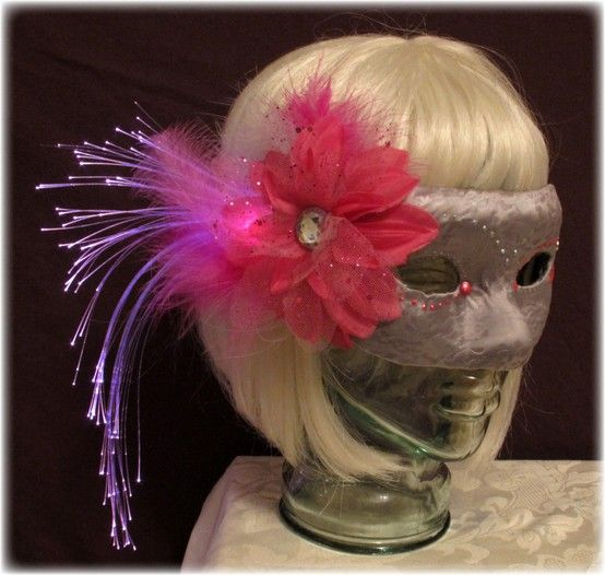 Women's fiber optic, feather masquerade mask by Team Rainbow Designs, with pink fiber optic lights. Mask is fastened with ribbon ties.    Fiber optic lights have an on, off switch. All items come with an extra set of batteries.    Custom orders are encouraged. Work with us to create the perfect item for you! To make a custom order, please email . $40.       best rave lights