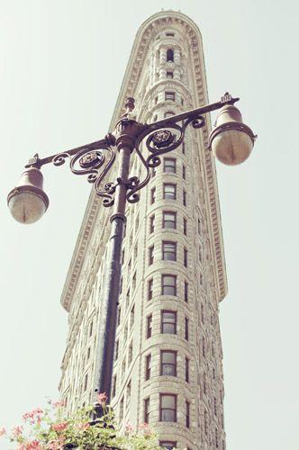 Flatiron Building, NYC w/ beautiful streetlights in front