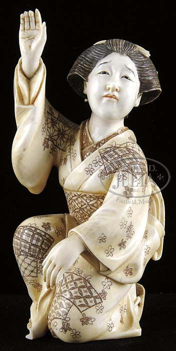 """CARVED IVORY FIGURE OF A GEISHA. Japan. This signed example of a female figure gesturing with her right hand in the air and in a kneeling position in a floral decorated kimono. SIZE: 5-1/4""""h."""