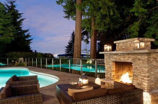 Fireplace next to the pool offers a wonderful focal point for the