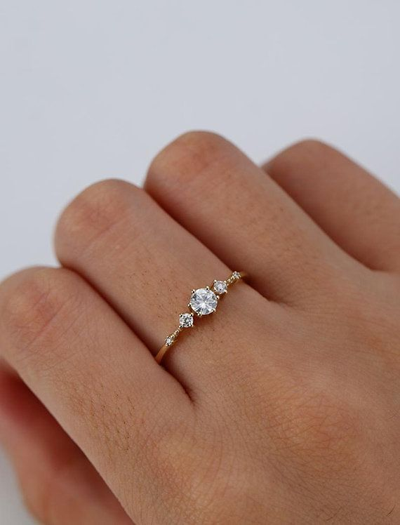 Photo of Unique engagement ring in solid 14 carat gold moissani …