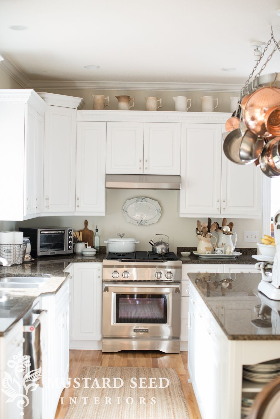 Elegant Carrara Countertops with White Cabinets