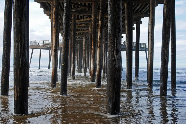 Under the pier at Pismo Beach, CA by ntiwata, via Flickr