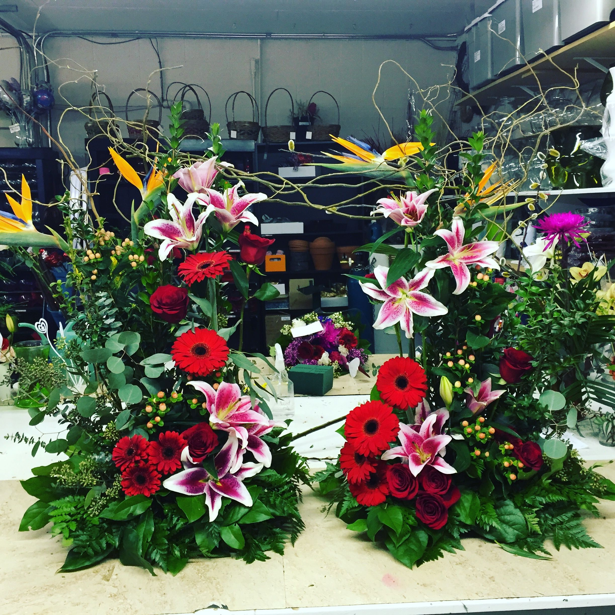 A beautiful urn spray made with red roses stargazer lilies birds order flowers directly from the rose garden your local lethbridge ab florist and flower shop to save time and money izmirmasajfo Choice Image