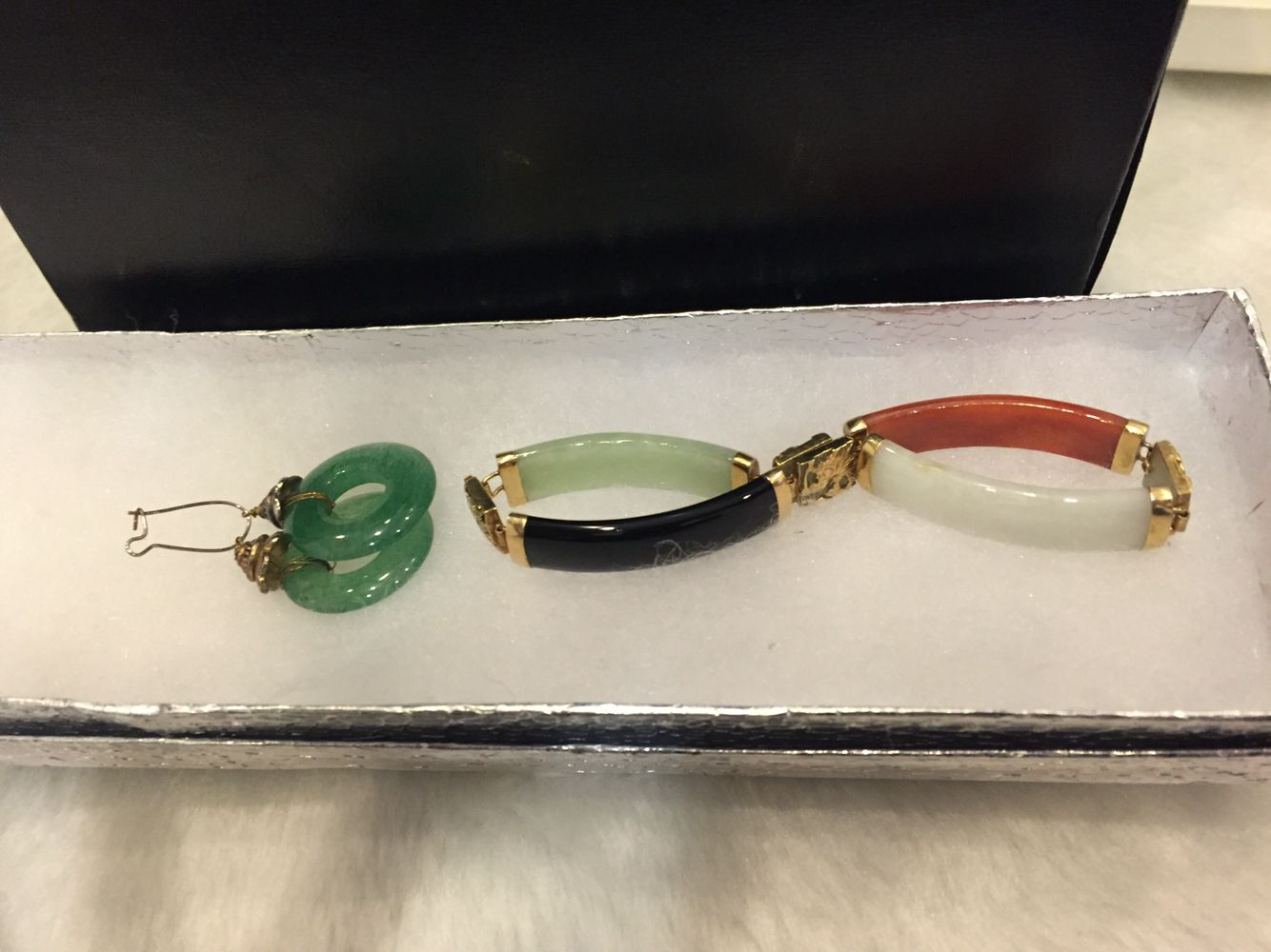 Jade earrings $ 30 and jade , precious stone with gold in between each connecting stone $ 50 Together as a set $75