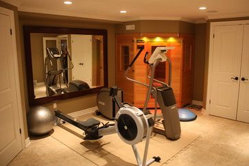 a small home gym  equipment mirror  workout room home