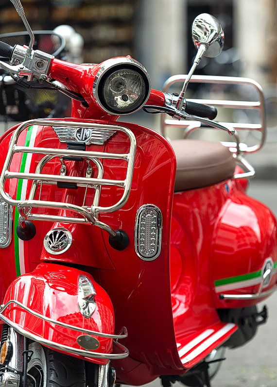 red vespa in italy scooter moped rome italy red white green