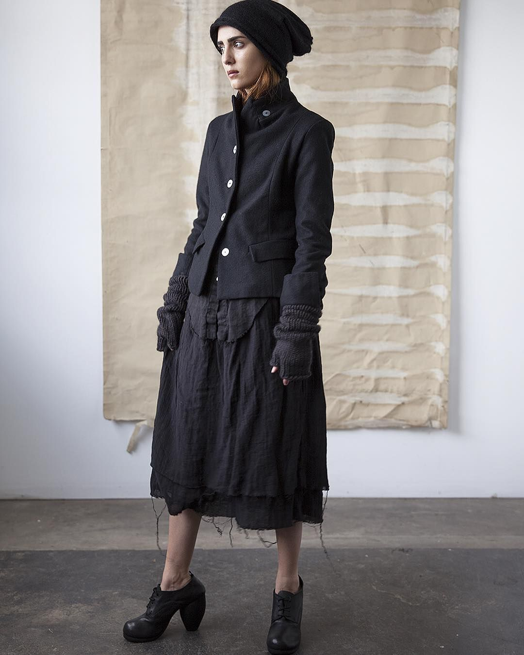 Isolde wool jacket, linen stand collar shirt and double layer linen skirt.  Knit hat, gloves and shoes available at @cendre_boutique  Model is Narges Qurban @lesnympheas #ovate #handmade #cendreboutique