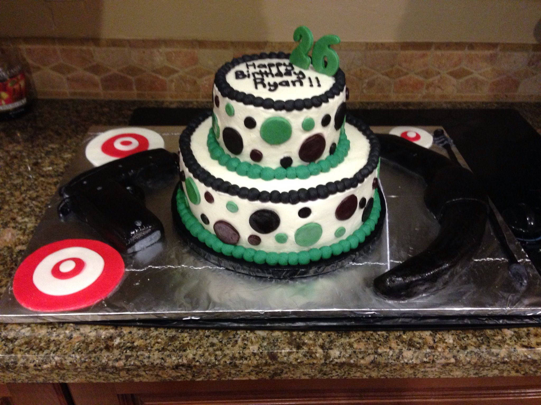 Bulls eye cake with bow and arrow and gun all edible. www.facebook.com/day.dream.cupcakes