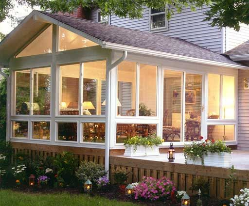 Sunroom off the kitchen for entertaining home decorating for Sunroom and patio designs