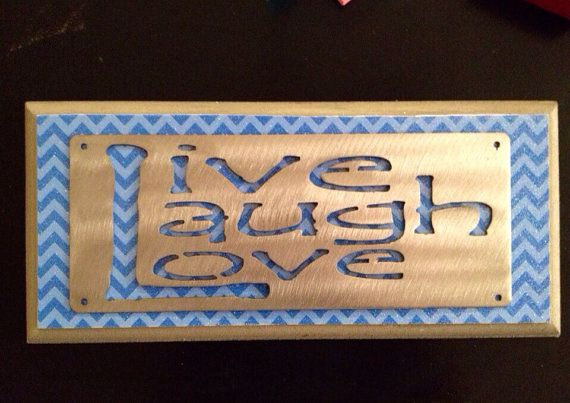 Live laugh love metal sign on wooden wall by SilverLaceCrafts
